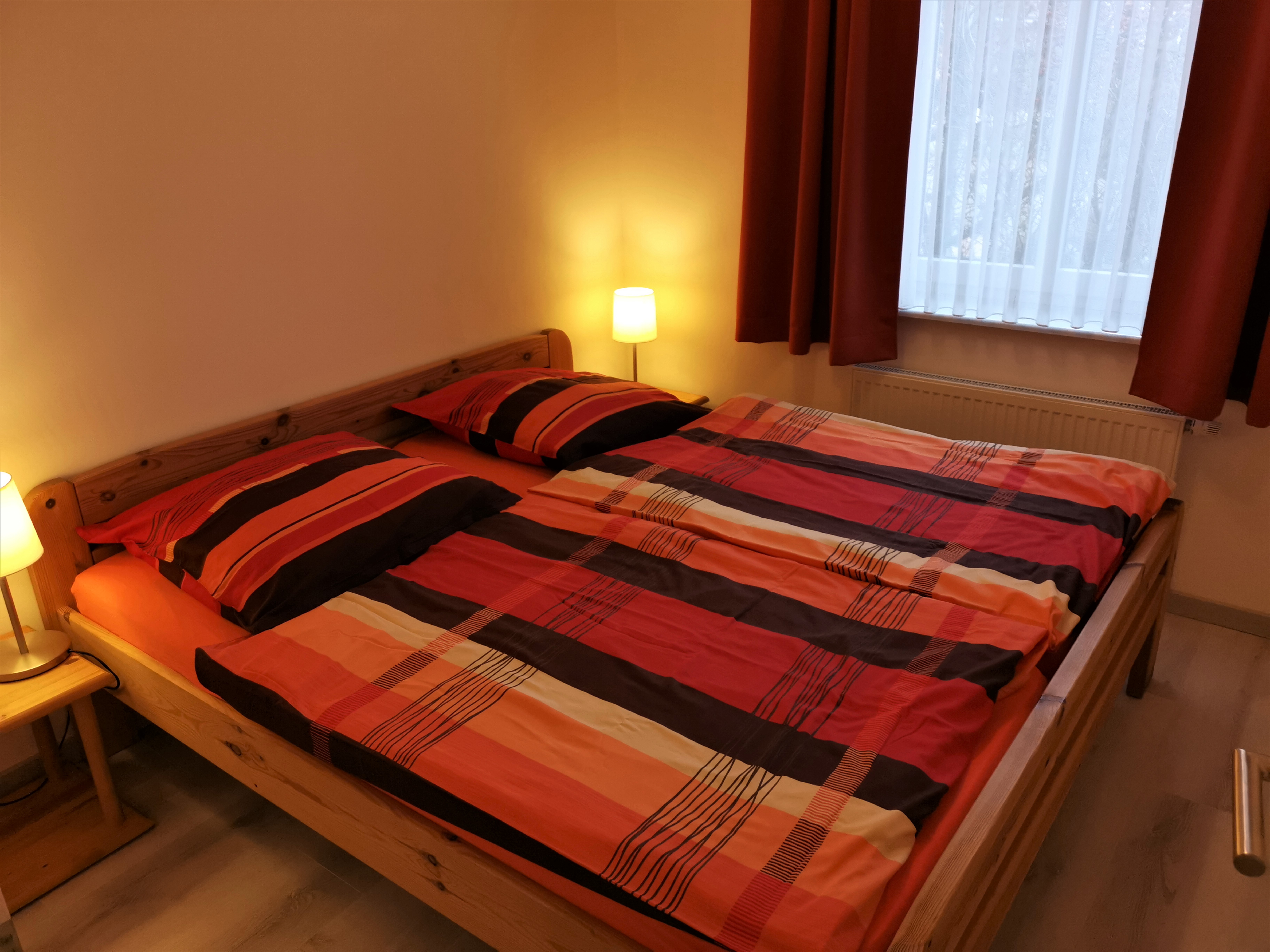 Schlafzimmer der Ferienwohnung Heide von Ferienwohnungen Hass auf Fehmarn