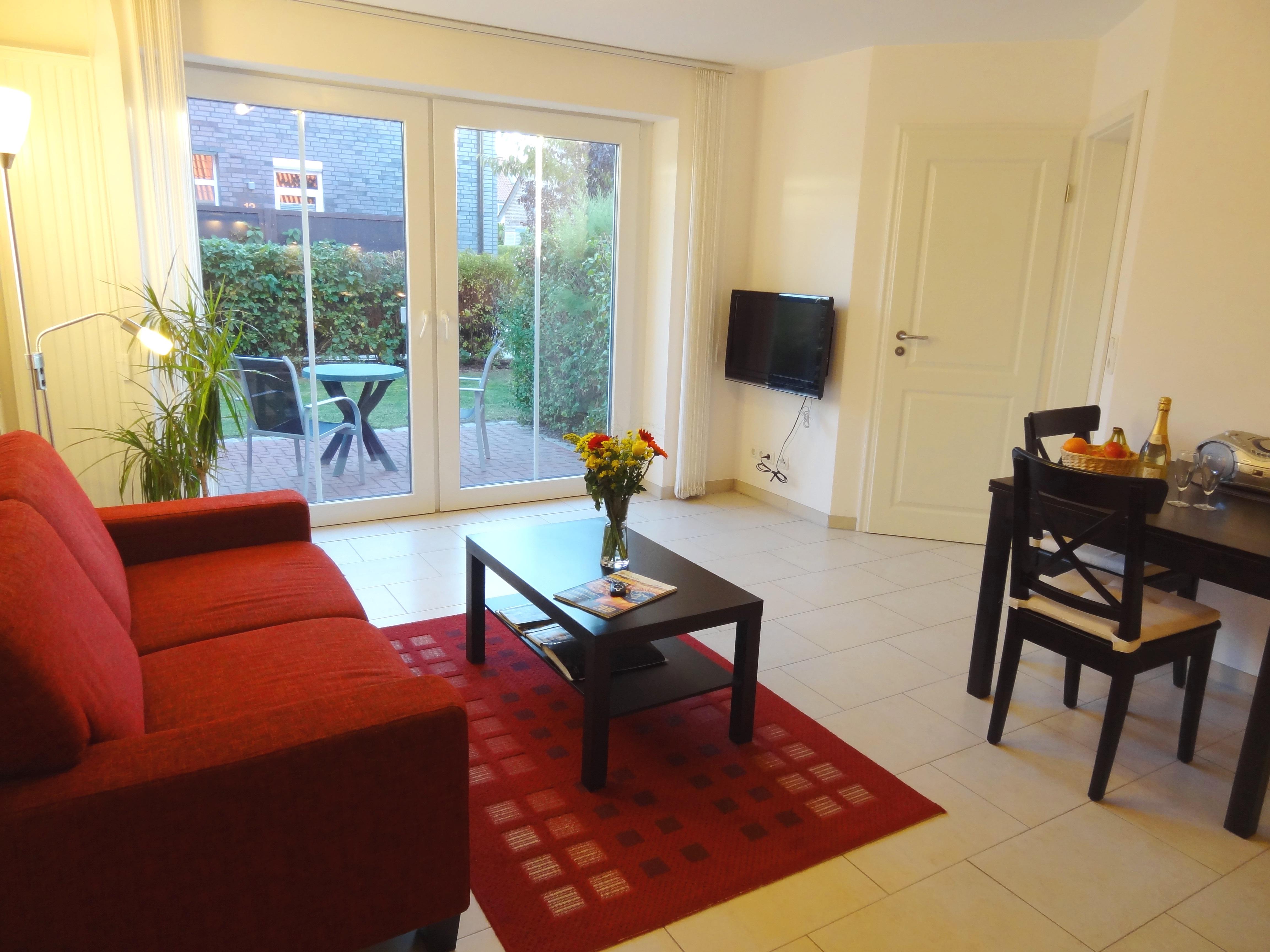 Wohnzimmer mit Terrasse der Ferienwohnung Witten von Ferienwohnungen Hass auf Fehmarn