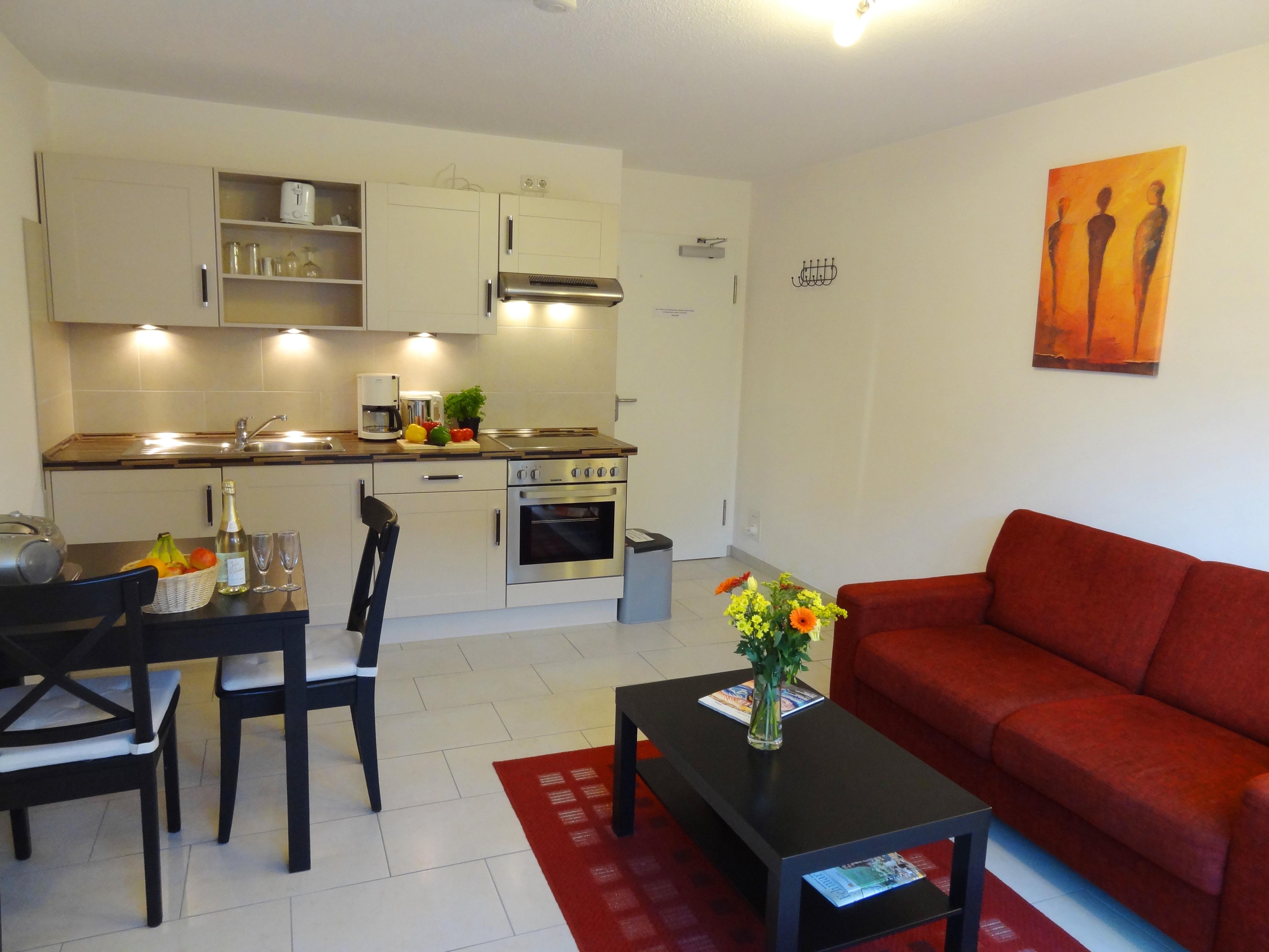 Wohnzimmer mit Essbereich der Ferienwohnung Witten von Ferienwohnungen Hass auf Fehmarn